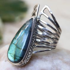 Teardrop cabochon labradorite ring in silver bezel setting with sterling silver skeleton multi wrap band