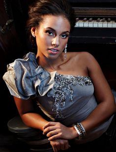 """Alicia Keys - The second American recording artist to win five Grammys in one night. The first female to have an MTV Unplugged album debut at number one.  My Favorite songs; """"Fallin,"""" """"Empire State of Mind w/Jay Z,"""" Sleeping with a Broken Heart,"""" """"Girl on Fire,"""" and """"No One."""""""