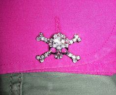 Metal & diamanté skull & cross bone cufflinks: Vivienne Westwood /Fuchsia cotton French-cuff fitted shirt: River Island