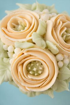 Learn how to make these simple buttercream ribbon roses to decorate your cakes and cupcakes. This tutorial and video will show you how.