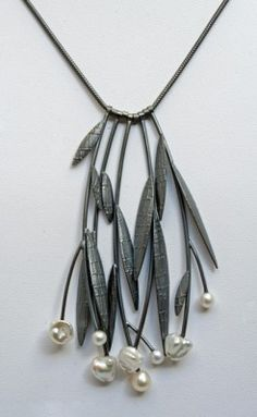 DIY this Sydney Lynch necklace with leather thong, leaves cut from scrap leather and pearl beads