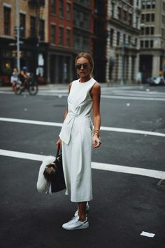 fashion-clue:  justthedesign:  Work culottes into an all white outfit by matching them with a tie-front shirt and sneakers. Via Nina Suess Shops: Not Specified  www.fashionclue.net| Fashion Tumblr, Street Wear & Outfits