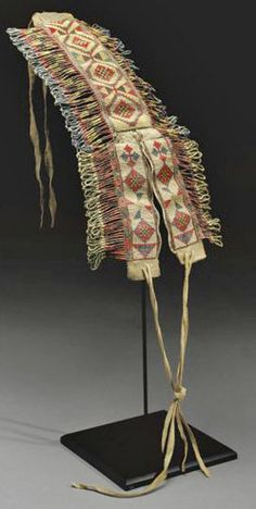Porcupine quillwork of the sioux or Cree, saddle crupper made of tanned buffalo hide and porcupine quills ...