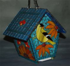 Its time to plan for Spring! Soon, the nesting season will begin and youll can be watching the birds come and go through this whimsical sunflower face! This stained glass mosaic bird house can be used outdoors or displayed inside. Designed to be the perfect size for our wonderful small songbirds. Complete with a removable base for cleaning and ventilation on the sides under the roof. The entire house is sealed for outdoor use. Hangs from an 8 double chain with hook on the top. For safety of…