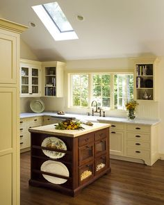 Kitchen with pale yellow cabinets and dark, antique wood island, luxury appliances and a dramatic vaulted ceiling. Yellow Kitchen Accents, Yellow Kitchen Cabinets, Grey Kitchen Walls, Kitchen Redo, Kitchen Colors, Kitchen And Bath, New Kitchen, Yellow Accents, White Cabinets