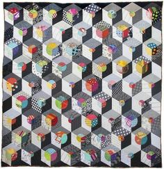 Opal Essence quilt by Lorena Uriarte. Tumbling blocks with circles. 2015 Workshop at Material Obsession.