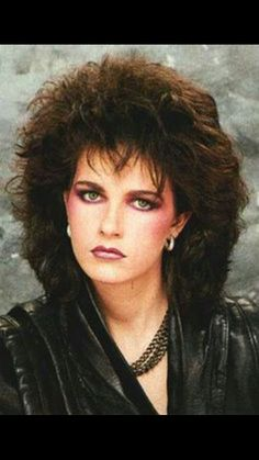 1980s makeup and hair...personally, i hate this look, but