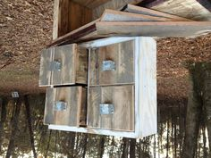 Old window frame and pallet wood make a good file cabinet