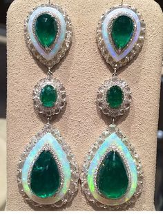 Coomi Emerald , Opal , and Diamond earrings .