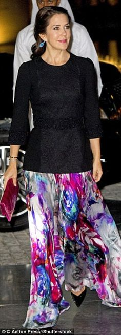 Colourful: Mary wore a bright silk skirt paired with a hot pink clutch...