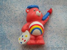 I have this Cheer Bear figurine, though she's not in as good condition. It was the decoration on my 6th birthday cake. My fave Care Bear of them all.