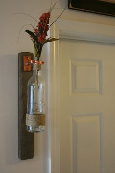 Recycled Wine Bottle Vase with wooden hanger by UnCorkdArt on Etsy, $25.00