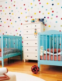 Polka dots add whimsy in this modern, colorful nursery.