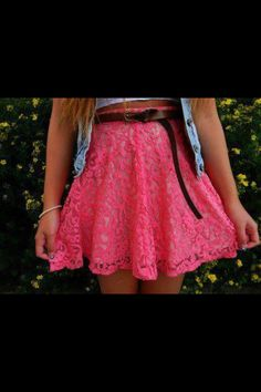 This skirt captures spring to me with the beautiful coral pink color and the lace topped off with a brown belt.