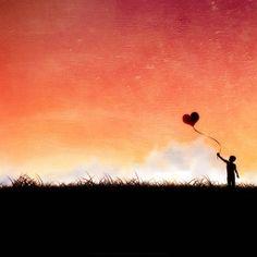 Love graphic - Heart shaped balloon  - A boy holding a heart shaped balloon