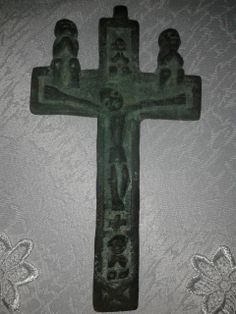 Cast bronze or brass. Height 15.5 inch, shoulder width 9 inches.