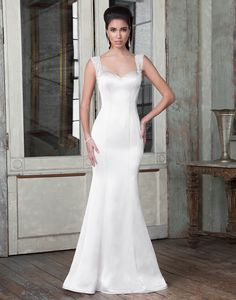 Impeccably structured Luxe Charmeuse sweetheart fit and flare gown featuring couture seaming, hand beaded crystal and pearl straps, and a showstopping deep V-back. https://www.justinalexanderbridal.com/signature_wedding_dresses/9806