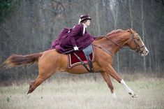 Side saddle gallop - love the saddle pad, love the outfit!!!