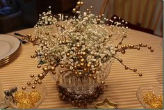 Lovely gold and gysophila (baby's breath) centerpiece from this website http://www.cuisinekathleen.com/2012/01/following-yonder-star.html