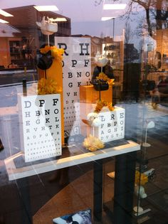 Great display for front windows on optical. Reminder that we need tables or something at windows to rotate displays. Spring Window Display, Store Window Displays, Display Windows, Retail Displays, Shop Windows, Shop Front Design, Store Design, Optometry Office, Optical Shop