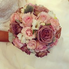 Soft pinks with freesia, spray roses, garden roses, amnesia roses and dusty miller. Designed by: www.simplifiedcelebrations.com