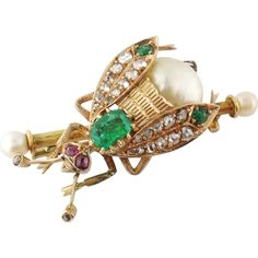 Description: Antique Victorian 18K Rose Gold, Natural Pearl, Rose-cut Diamond and Emerald Fly Brooch Brooch designed as an insect resembling a fly