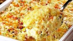 Ingrediente: 4-5 pahare orez fiert 130 gr sunca maruntita 130 gr mozzarella data pe razatoare 1 morcov spalat si dat pe razatoare 1-2 lingurite patrunjel tocat marunt 1 pahar lapte