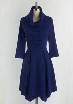 Standing center stage, you share an adventurous anecdote while wearing the cute cowl neck and pleated skirt accents of this ModCloth-exclusive dress! With its textured, deep indigo tone and front ruching, you finish with a bow, reveling in the enthusiastic applause of a delighted crowd!