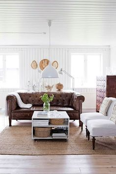 Brown leather sofa with light fabric chairs -- love this pairing