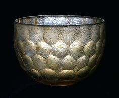"Bowl, thick, colorless glass, facet-cut, Sasanian, Iran or Iraq, 6th-7th C. It is covered entirely by a pattern of hexagonal, slightly concave facets that were cut on a grinding wheel. The form of the facets varies slightly so that the pattern can continue uninterrupted from top to bottom. This type of ""honeycomb"" decoration was adopted by the early Islamic glassmakers, who used it on glass objects in other shapes. Renowned Sasanian glass was exported all the way to the Far East."
