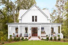 Say hello to the hardest-working porch in Georgia. As you've seen, it's a sitting room, mudroom, potting station, and breakfast nook rolled into one—the perfect way to take advantage of a yearly average temperature of 62 degrees. (Porch Step Southern Living)