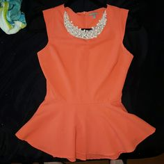 Peplum Top Gorgeous peplum Top in salmon with beaded accent around neck! Mild wear and tear, but you can hardly tell! Charlotte Russe Tops Blouses