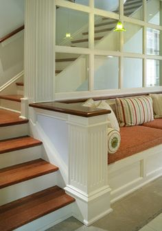 Built-in window seat at stair landing by Sussan Lari Architect.