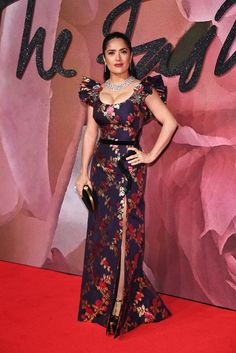 In a Gucci Spring Summer 2017 silk jacquard gown with embroidered patches, Salma Hayek Pinault captured on the red carpet of the British Fashion Council Awards.