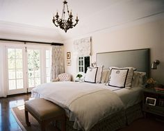 Neutral walls paired with monogrammed bedding