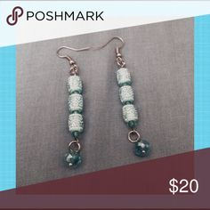 "Turquoise Beaded Earrings Turquoise & white beads hang from stainless steel ear wires. There are dangling turquoise crystals at the bottom. Earrings are 2"" long. Jewelry Earrings"