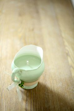 This is a pretty mint green PARAGON vintage milk jug / creamer. Its stamped *Paragon, the Queen and Queen Mary, fine bone china, England* at the back. It is filled with 200ml / 7oz. eco soy wax in soft green colour to complement its own colour. It is scented with apple and mint paraben free fragrance oil. The jug is adorned with hand wired green marble round beads (as mini apples :-) ) and a tiny ivory satin bow. Isnt it sweet?  This would make a lovely gift, wedding favour, or comp...