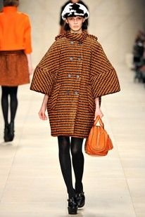 Burberry Prorsum Autumn/Winter 2011-12. Exaggerated sleeve that causes a interesting silhouette to be created. Makes the women's body look slimmer.