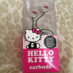 Hello Kitty rhinestone earbuds New Hello Kitty rhinestones earbuds earbuds have kitty's face on them red bows and yellow nose clear stones, new never used. Compatible with apple, blackberry, androids. Sanrio Accessories