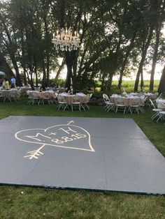 build a dance floor outside, suspended chandelier in the center  Visit sibylsophia.com for flowers for events and weddings in the LA area!