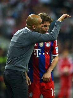 The boss giving the kid some directions. Bayern vs Wolfsburg 22.08.14