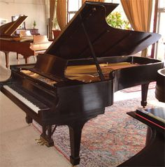 Steinway grand piano model 'D'. Rebuilt in the 1980's, this 9' concert grand is the king of all pianos!