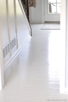 How to paint prefinished hardwood floors- love how they turned out!
