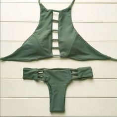 Olive green bathing suit new! never worn just tried on, doesn't fit the way I wanted it to! the bottoms are cheeky. would look better on someone with a smaller chest than me.      :(       NOT ACACIA                       price negotiable!!! acacia swimwear Swim Bikinis