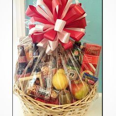 Custom Gift basket made with beer, fruit, cheese, crackers and a variety of other snacks!