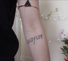 "Dexter tattoo ""Slice of Life""  (screenshot from Georgia Cinnamon @ YouTube)"