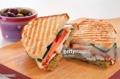 This chicken panini sandwich recipe is made with grilled chicken, pesto and Italian cheese. Some chicken panini recipes use Italian bread, but I like sourdough for this chicken panini sandwich recipe. Pesto Panini Recipe, Chicken Pesto Panini, Panini Recipes, Grilled Chicken, Grilling Recipes, Cooked Chicken, Panini Sandwiches, Delicious Sandwiches, Vegetarian Sandwiches