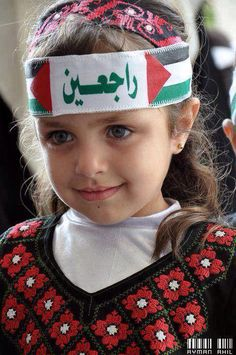 """What is written on her forehead is """"We are coming back """" ."""
