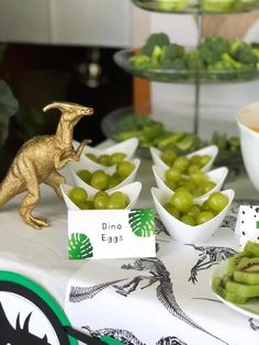 """Dinosaur Birthday Party Ideas Green grape """"dino eggs"""" make all the herbivores happy! Simple editable Dinosaur party food labels take the party up a notch! Available from the HalfpintPartyDesign shop on Etsy. See all the dinosaur birt Park Birthday, Dinosaur Birthday Party, 3rd Birthday Parties, Birthday Party Decorations, Dinosaur Themed Food, Third Birthday, Dinosaur Party Foods, Dinosaur Decorations, 5th Birthday Ideas For Boys"""