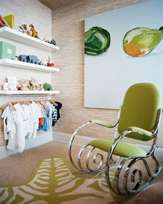 Accented Nursery Design  I love the hanging clothes idea plus that rocking chair is beautiful